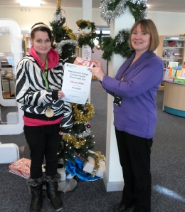 Joint winner Stacey Collins (left) receives her certificate
